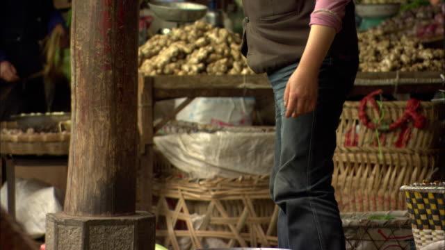 MS Merchant at Zhongyi outdoor market, Lijiang, Yunnan, China