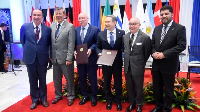 mercosur member countries sign an agreement with canada to extend talks on a mercosur canada free trade deal at the foreign ministry in asuncion... - mercosur stock videos & royalty-free footage