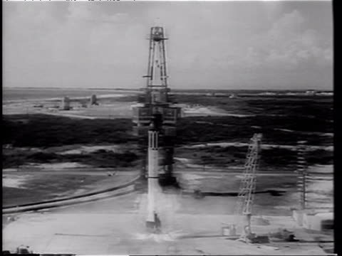 mercury 3 rocket on launch pad at night / alan shepard's flight - first american in space / flight crew helping alan shepard into space capsule /... - 1961 stock videos & royalty-free footage