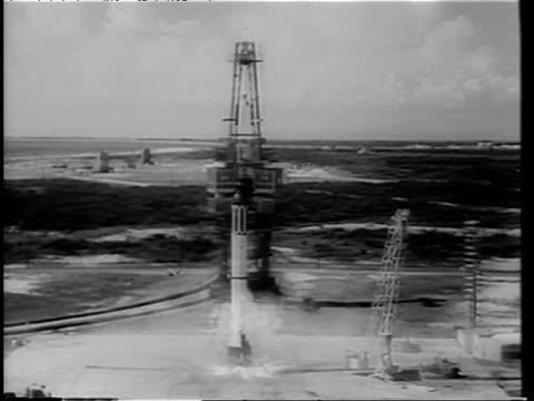 vidéos et rushes de mercury 3 rocket on launch pad at night / alan shepard's flight - first american in space / flight crew helping alan shepard into space capsule /... - 1961