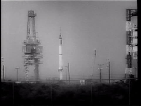 mercury 4 rocket blasting off from launch pad / row of men at control panels in mission control / astronaut gus grissom being lifted from ocean to... - splashdown stock videos and b-roll footage