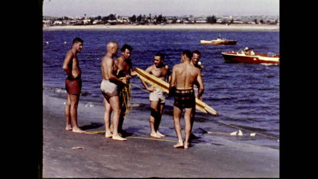 vídeos de stock e filmes b-roll de mercury 7 astronauts relaxing surfing and waterskiing on january 01 1961 - 1961