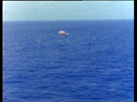 mercury atlas 9, capsule splashdown into ocean with parachute - splashdown stock videos and b-roll footage