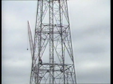 appeals court ruling england london/ / satellite dishes on roof/ telephone pylon tower under construction/ lib ends/ derek evans interview sot/ - pylon stock videos and b-roll footage