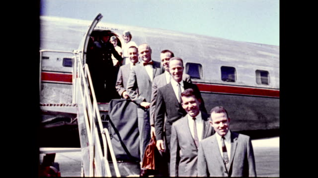 mercury program astronauts deplaning from american airlines airplane, wearing suits and posing for photographs on january 01, 1961 - 1961 stock videos & royalty-free footage