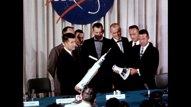 Mercury Program astronauts introduced at press conference for America's first manned space program / astronauts sitting at table including Scott...