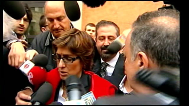 meredith kercher murder trial: rudy herman guede convicted; perugia: ext female lawyer speaking to press outside court - perugia stock videos & royalty-free footage