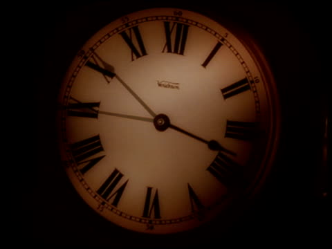 merged shots of clock hands going round a clock - changing clock stock videos and b-roll footage