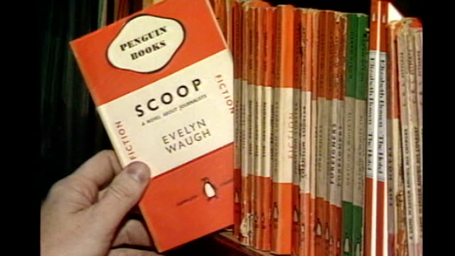 merger between penguin and random house publishers planned 132500 / middlesex penguin warehouse int 'scoop' by evelyn waugh book pulled out of shelf... - flightless bird stock videos & royalty-free footage
