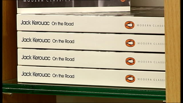 merger between penguin and random house publishers planned london modern penguin books on shelf lee child books on shelf tilt 'fifty shades of grey'... - bookseller stock videos and b-roll footage