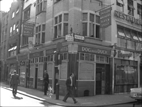 merger of ind coope and taylor walker breweries england london ext exterior gv of 'doc and duck' taylor walker pub in frith street exterior gv of... - 1950 1959 stock videos & royalty-free footage