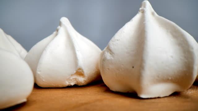 meringue kisses extreme closeup - meringue stock videos & royalty-free footage