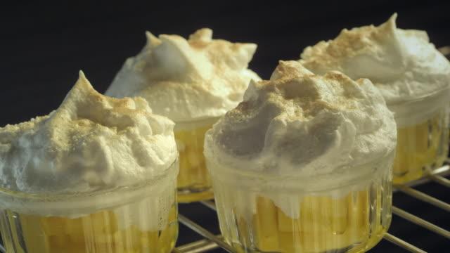 meringues bake in an oven. - meringue stock videos & royalty-free footage