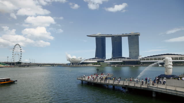 tl ws merlion park and marina bay sands with singapore flyer at marina bay - singapore flyer stock videos and b-roll footage