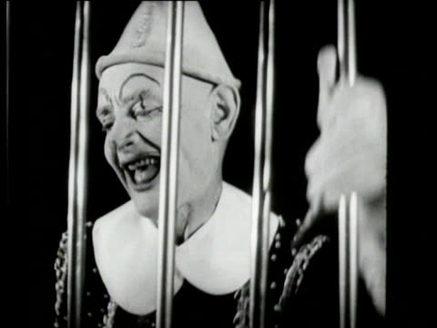 stockvideo's en b-roll-footage met a merry afternoon is organised for children whose fathers fight at the battlefront there are performances by a clown a magician and a rope walker - slagfront
