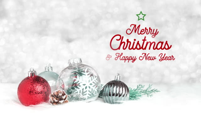 merry christmas and happy new year text floating on decoration ball on white fur at silver bokeh light background,holiday greeting card. - new year card stock videos & royalty-free footage