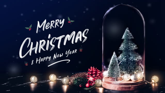 merry christmas and happy new year with mistletoe and gift box icon with xmas tree and glowing light string and pine cone decoration on marble table and blue background.winter holiday greeting card - christmas stock videos & royalty-free footage