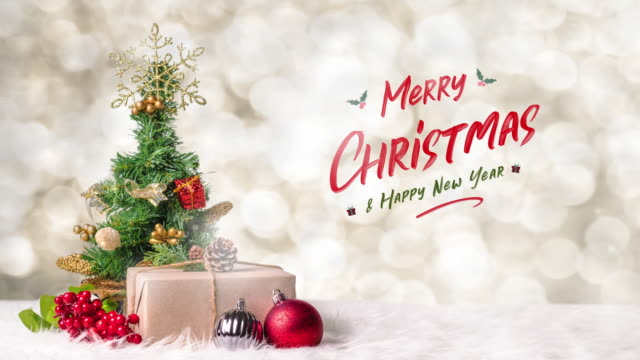 merry christmas and happy new year with xmas tree and gift box at blur bokeh light background,winter holiday banner greeting card - new year card stock videos & royalty-free footage