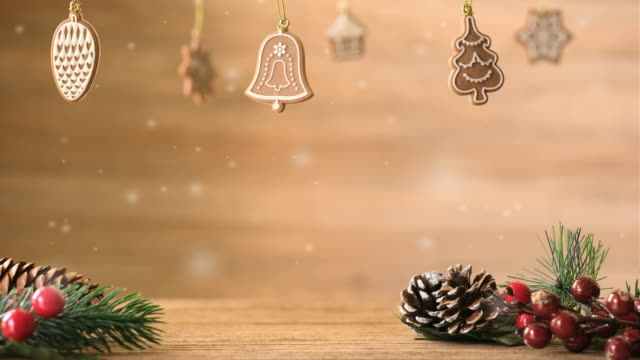 Merry Christmas new year background wiht Christmas tree and mistletoe leaf and pine cone on wooden table with snow fall.winter holiday seasonal greeting card