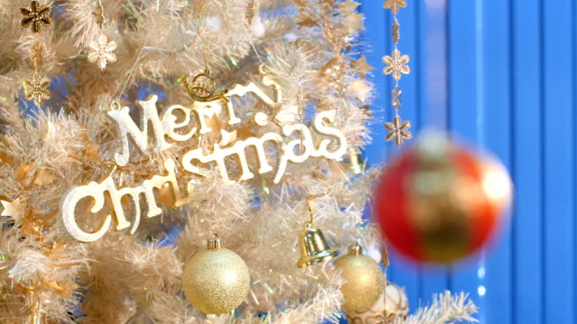 merry christmas text and red ball rack focus fast. - curtain wall facade stock videos and b-roll footage