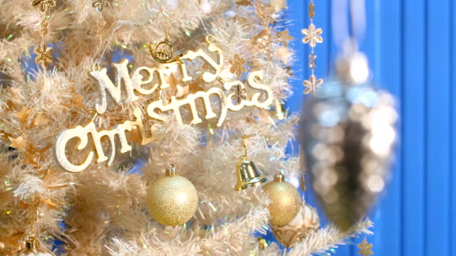 merry christmas text rack focus. - curtain wall facade stock videos and b-roll footage