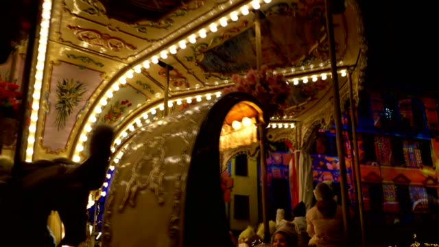 merry go round at night during the christmas holidays. december 2018, como - roundabout stock videos & royalty-free footage
