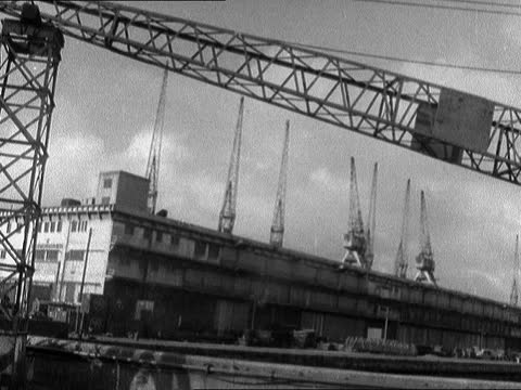 merseyside dockers strike over; england: liverpool: gladstone and canada docks: silent harbour bv one ship cms russian name on ship silent cranes... - chicago illinois stock videos & royalty-free footage
