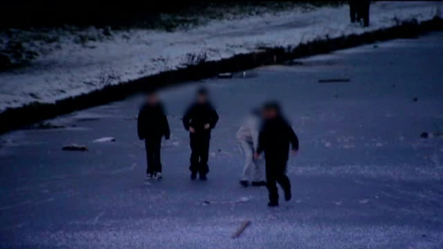 merseyside children walking and cycling on frozen lake - merseyside stock videos and b-roll footage
