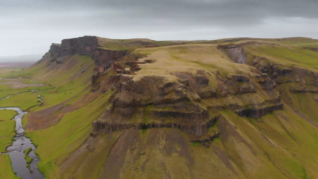 mesa mountain and river landscape in iceland - butte rocky outcrop stock videos & royalty-free footage