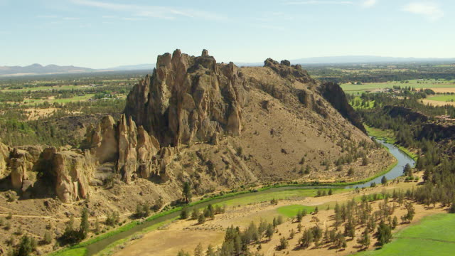 WS AERIAL Mesa Verde Wall at Smith Rock with Crooked River / Terrebonne, Oregon, United States
