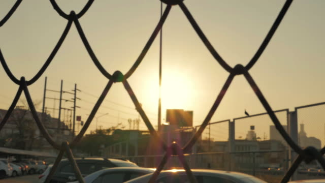 mesh fence and sun sky,slow motion - chainlink fence stock videos and b-roll footage