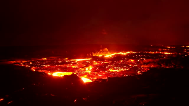 mesmerizing lava flow coming at you timelapse night glowing hot flow from kilauea active volcano puu oo vent active volcano magma - lava stock videos & royalty-free footage