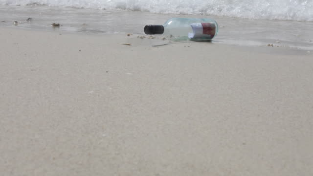 ms a message in a bottle on the shore of a beach - fitzroy island stock videos and b-roll footage