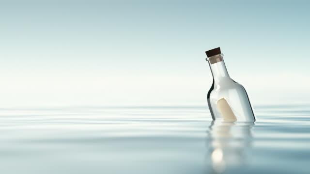 vídeos y material grabado en eventos de stock de mensaje en una botella - flotar sobre agua