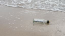 Message in Bottle on Beach
