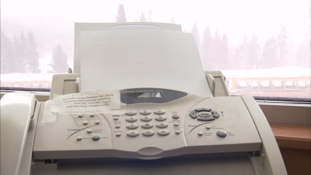 a message is sent through a fax machine. - fax machine stock videos & royalty-free footage