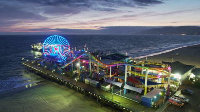 message to doctors and nurses in lights on ferris wheel of closed santa monica pier during covid-19 lockdown - santa monica pier stock videos & royalty-free footage
