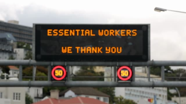 a message to essential service workers is displayed on an electronic billboard above wellington motorway on april 11 2020 in wellington new zealand... - new zealand stock videos & royalty-free footage