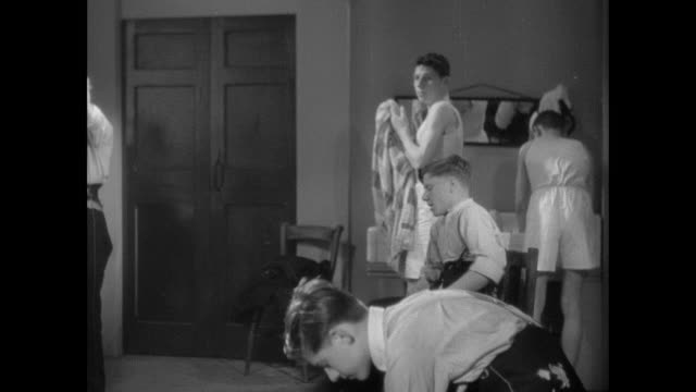 montage gpo messenger boys getting dressed in locker room and discussing school exams / england, united kingdom - locker room stock videos and b-roll footage