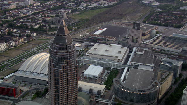 messeturm at dusk  - aerial view - hesse,  helicopter filming,  aerial video,  cineflex,  establishing shot,  germany - frankfurt main stock videos and b-roll footage