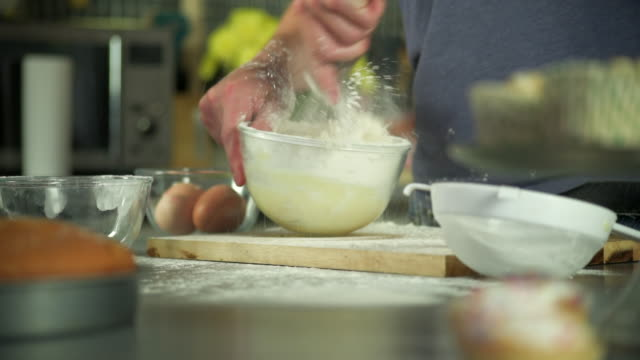 messily mixing flour - baking stock videos & royalty-free footage