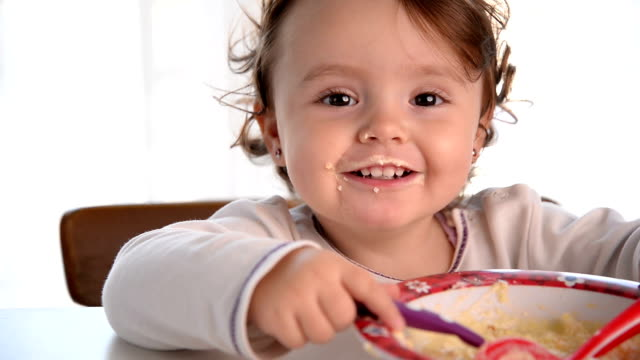 messy baby girl eating and smiling - one baby girl only stock videos & royalty-free footage