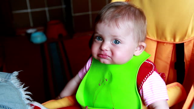 messy baby girl stares at camera - pulling funny faces stock videos & royalty-free footage