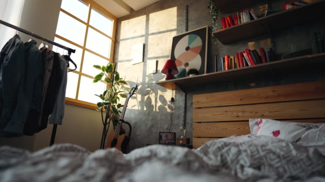 messy bed in the morning - modern bedroom stock videos & royalty-free footage