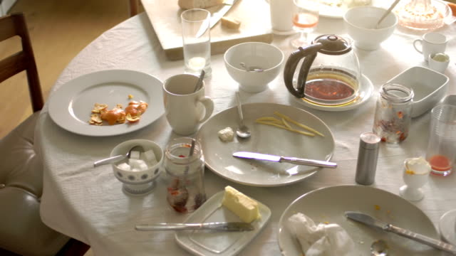 messy dining table after breakfast - leftovers stock videos & royalty-free footage