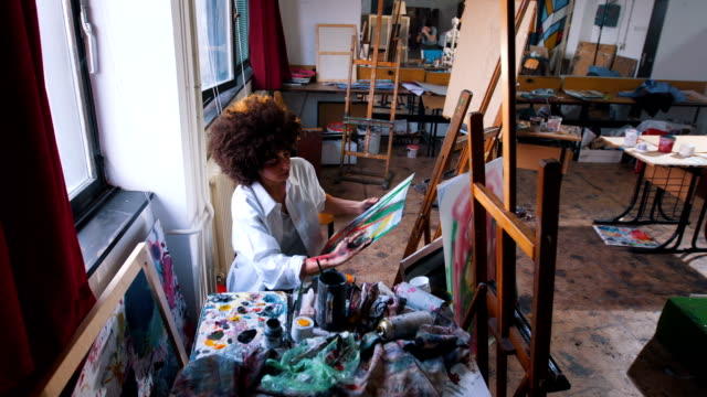 messy painter is deep into the process of painting - artist stock videos & royalty-free footage