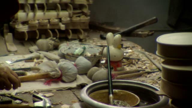 cu pan messy tabletop in workshop, hands of woman making violin, taizhou-taixing factory, taizhou, jiangsu, china - violin stock videos & royalty-free footage