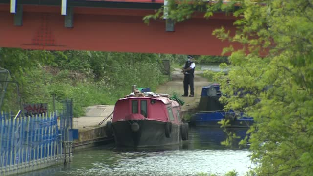 met appeal after body of newborn baby found in london canal; england: london: old oak lane: ext high angle view grand union canal and police tape... - rope stock videos & royalty-free footage