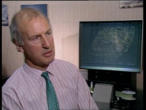 vídeos de stock e filmes b-roll de met office hurricane controversy bracknell meteorological office weathermen at work at deskstcbv weatherman transfering figures from paper to... - 1987
