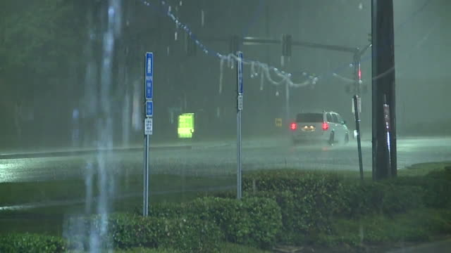 metairie, u.s. - traffic on streets in heavy rain and lightings at night on thursday, may 14, 2020. - thunderstorm stock videos & royalty-free footage